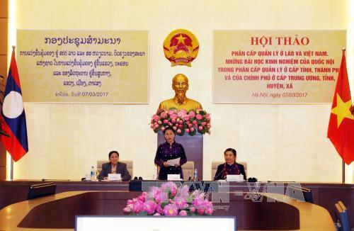 Vietnam, Laos exchange experiences in administrative management