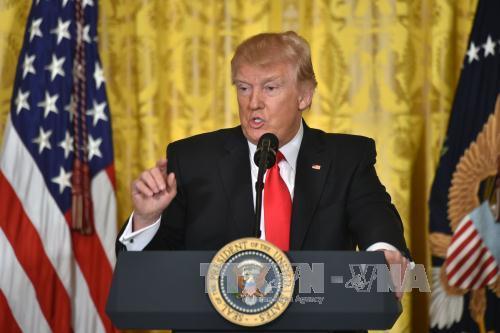 US President to delay revamped immigration order until next week