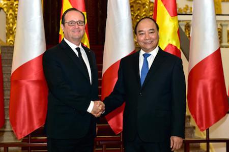 Primer ministro vietnamita recibe al presidente francés