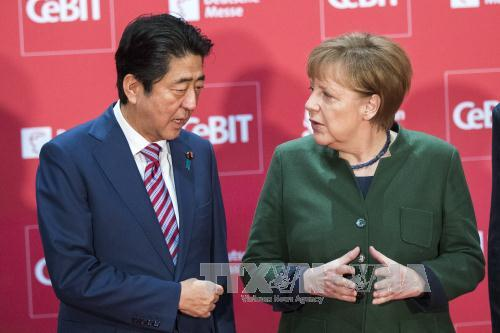 Japan, Germany commit to defending free trade
