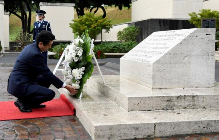 Japan's Abe pays respects at Hawaii memorials on eve of Pearl Harbor trip