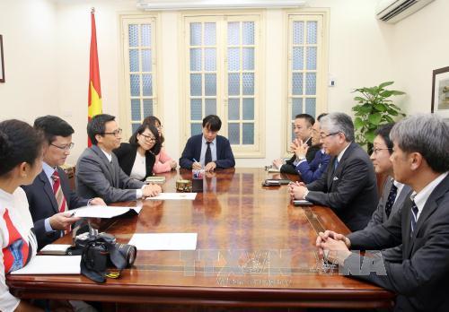 Deputy PM welcomes Asahi Shimbun President