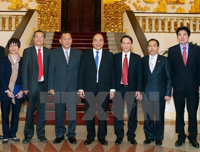 PM asks Vietnamese, Lao news agencies to foster links
