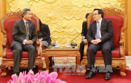党対外委員長、シンガポールの外務大臣と会見