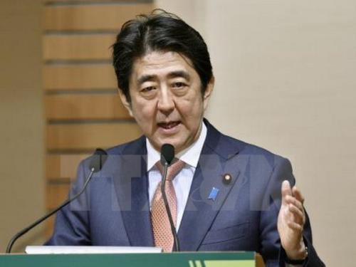 Japan vows to find new avenues for economic growth and ratify TPP trade deal