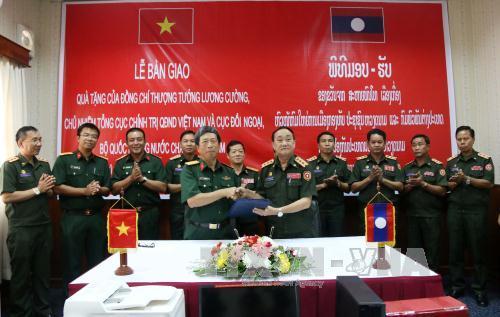 Việt Nam hỗ trợ các sư đoàn chủ lực của Lào tiến lên chính quy hiện đại