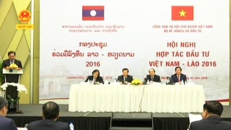 タナン市て、ヘトナム・ラオス投資協力第2回会議か行なわれる hinh 0