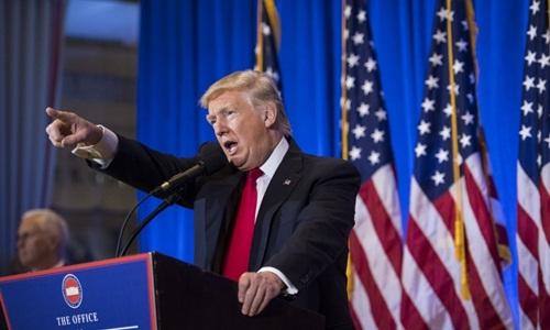 美国当选总统特朗普举行首次记者会 hinh 0
