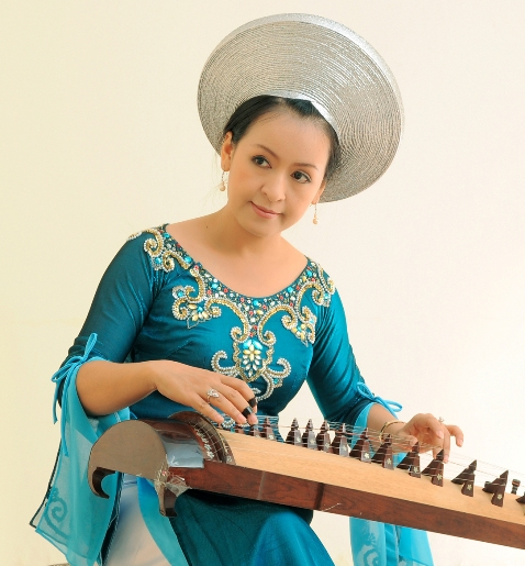 the 16-string zither - traditional vietnamese musical instrument hinh 1
