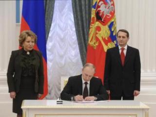 presiden rusia v.putin memberlakukan undang-undang tentang penggabungan krimea hinh 0